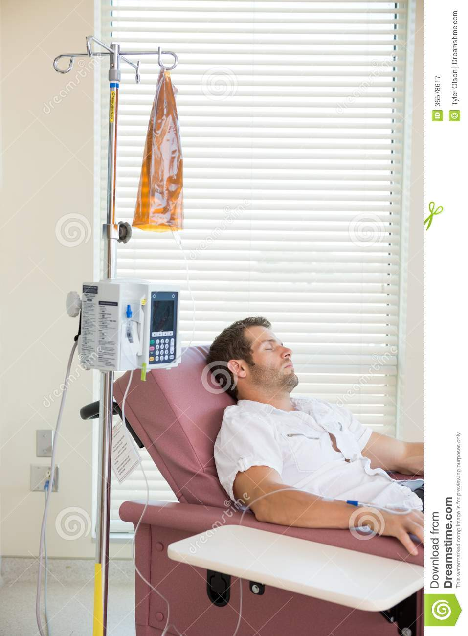 Chemotherapy Room Design: Patient Sleeping While Receiving Chemotherapy Royalty Free