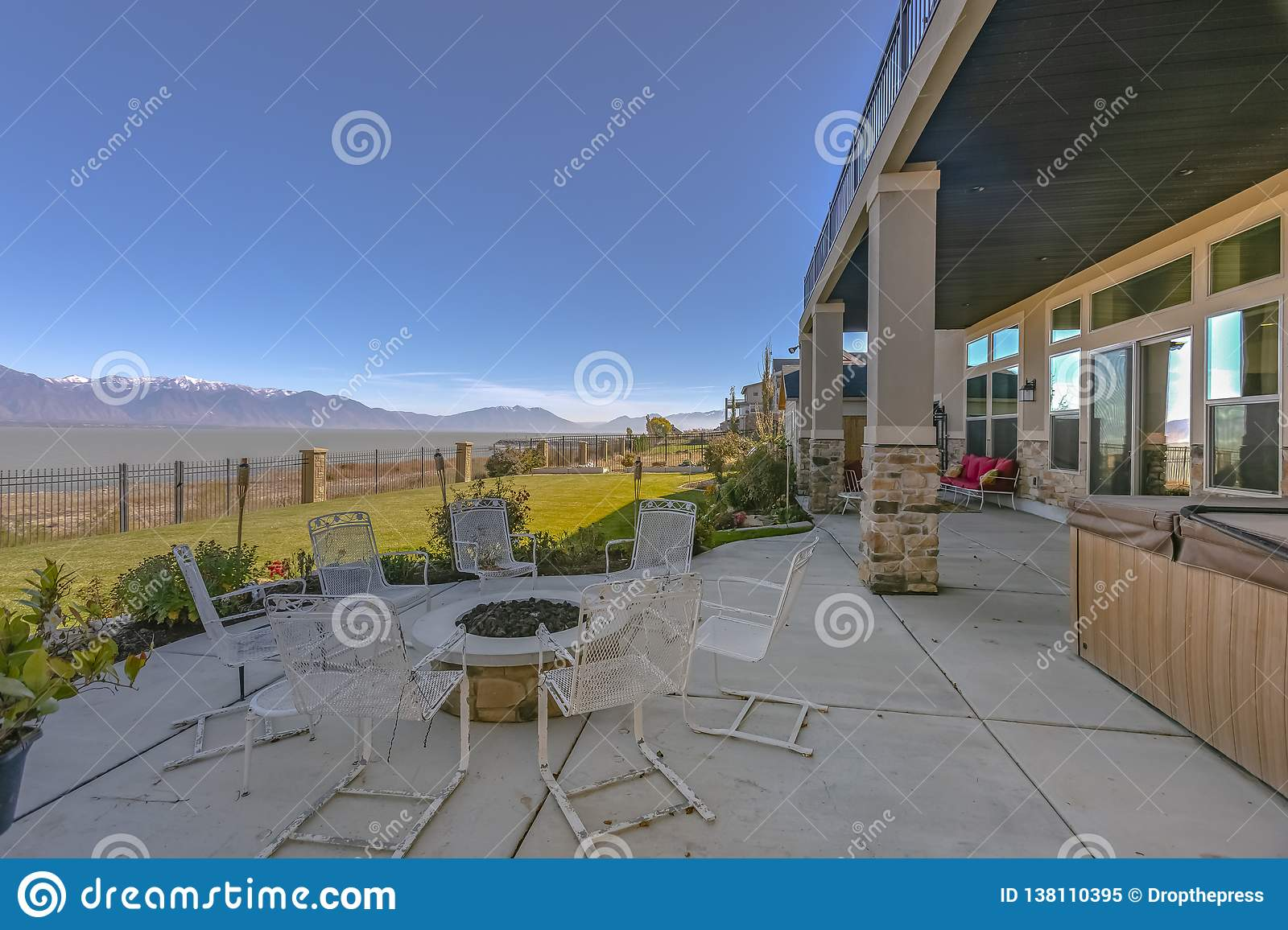 Patio with chairs around a circular fire pit