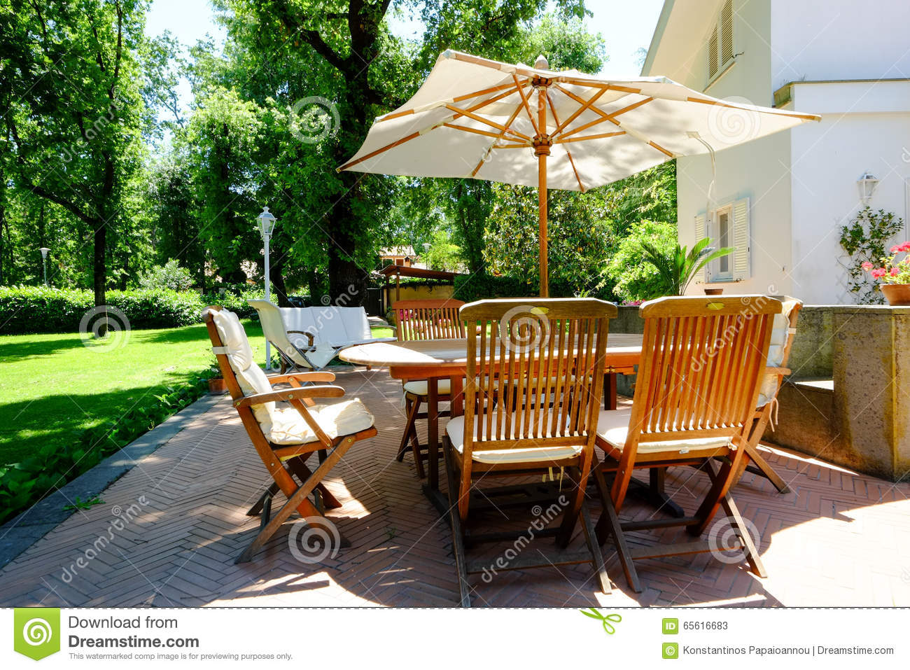 Backyard, patio and garden furniture in an Italian home - Patio Garden Furniture Stock Image. Image Of Design, Lifestyle