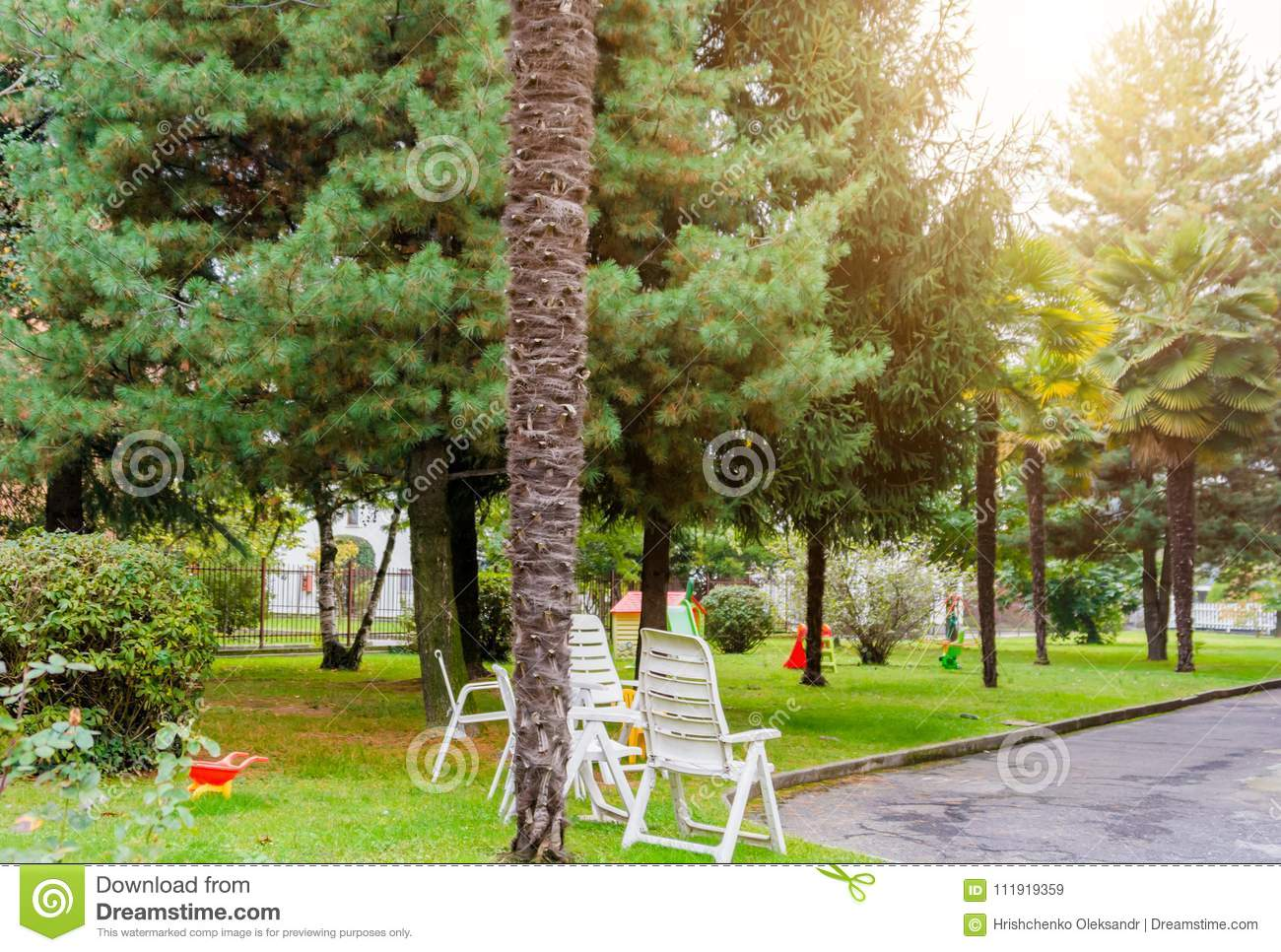 Patio With Palm Trees And A Children`s Playground In Italy