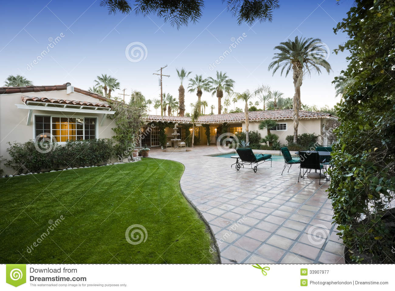 Patio With Pool In Front Of Modern House Royalty Free