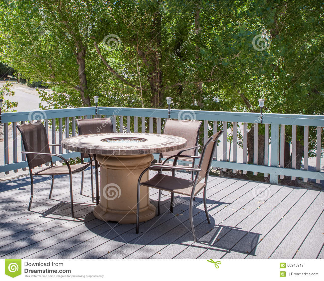 Patio Table With Fire Pit And Chairs On Deck