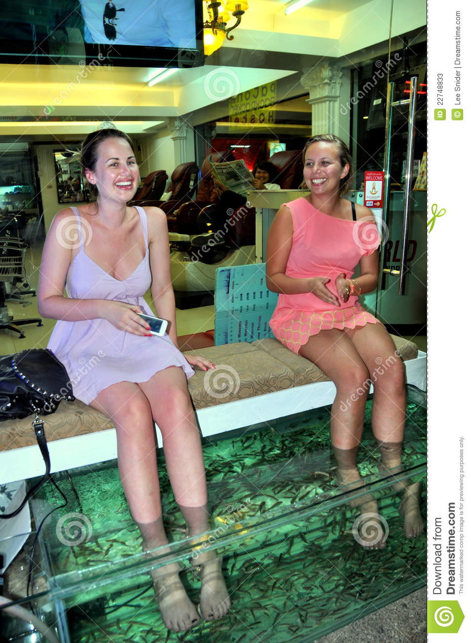 Patong thailand two women getting fish massage editorial stock photo