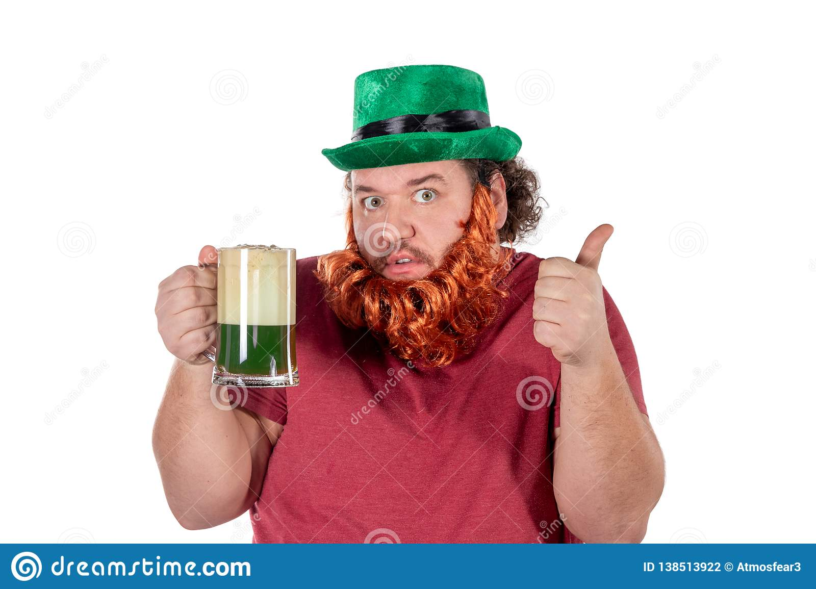 Patricks day party. Portrait of funny fat man holding glass of beer on St Patrick