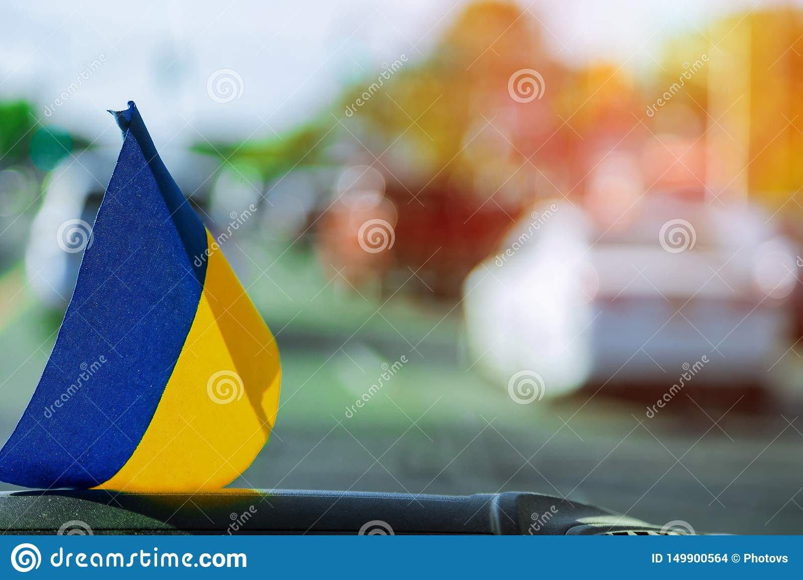 Ukrainian flag on glass inside the car