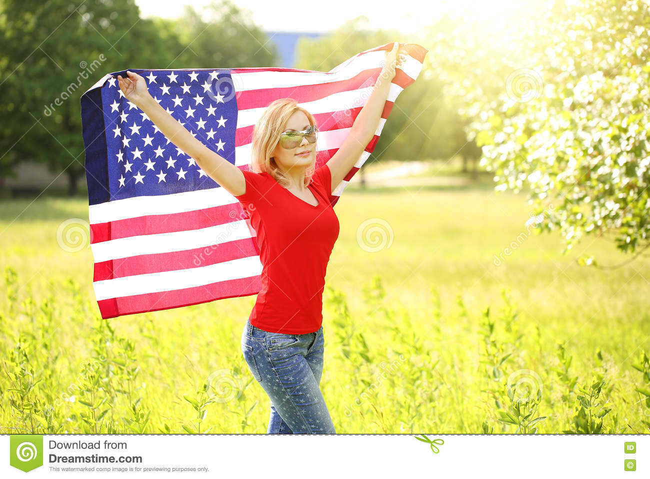 Patriotic young woman with American flag