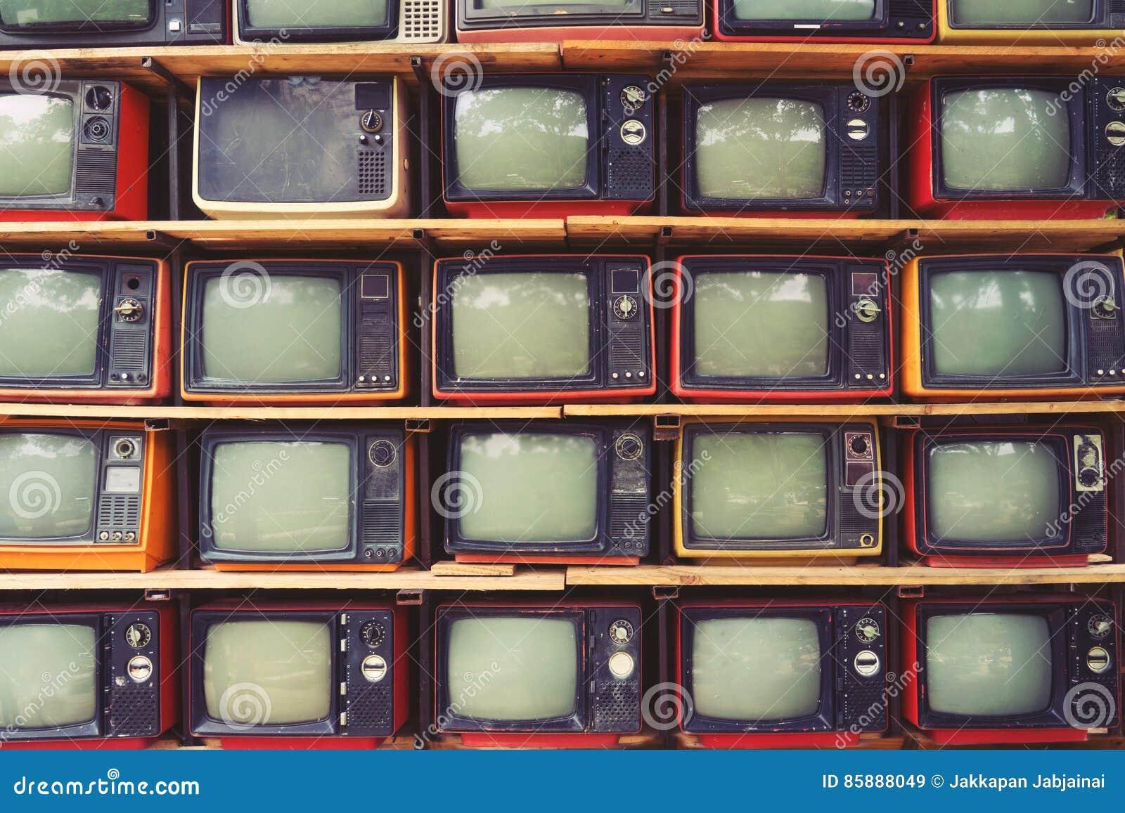 Patroonmuur van TV van de stapel kleurrijke retro televisie