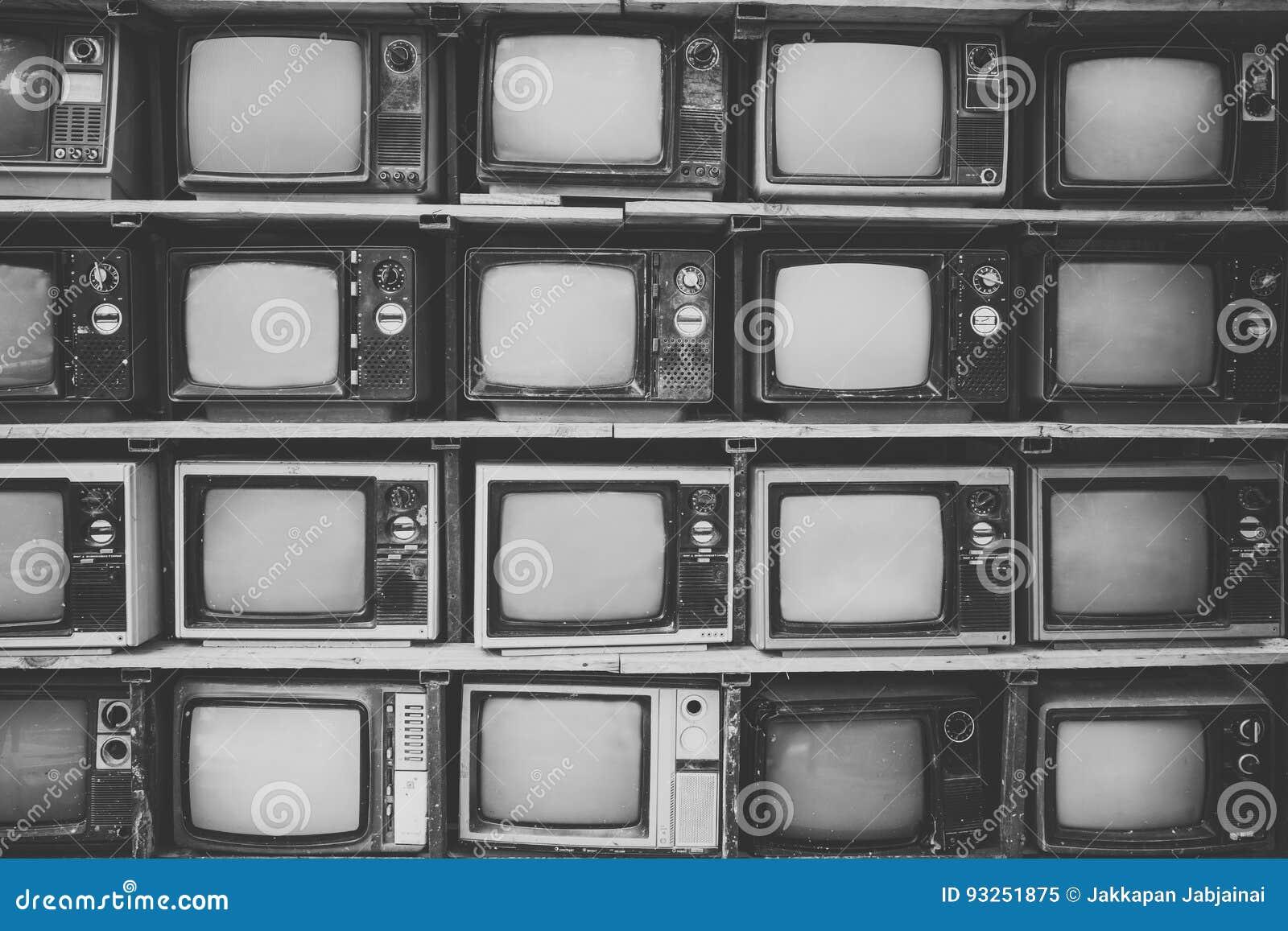 Patroonmuur van TV van de stapel zwart-witte retro televisie
