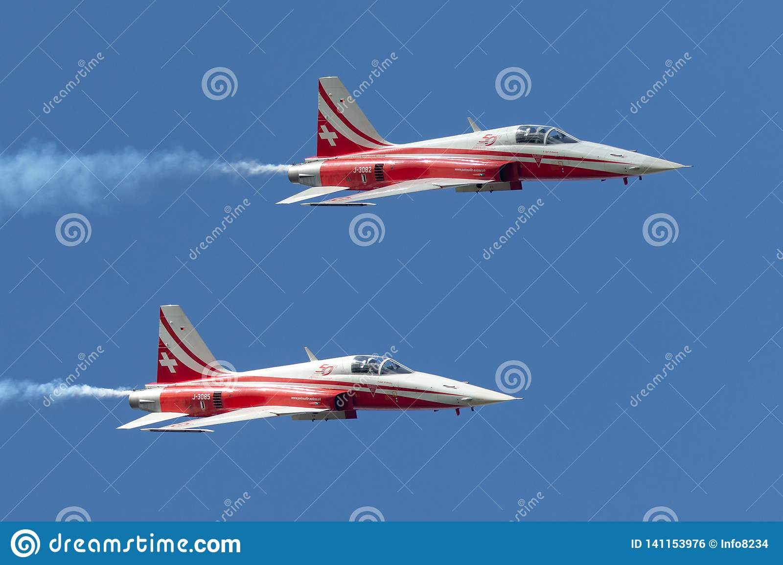 Patrouille Suisse formation display team of the Swiss Air Force flying Northrop F-5E fighter aircraft joined by the Swiss PC-7 tea