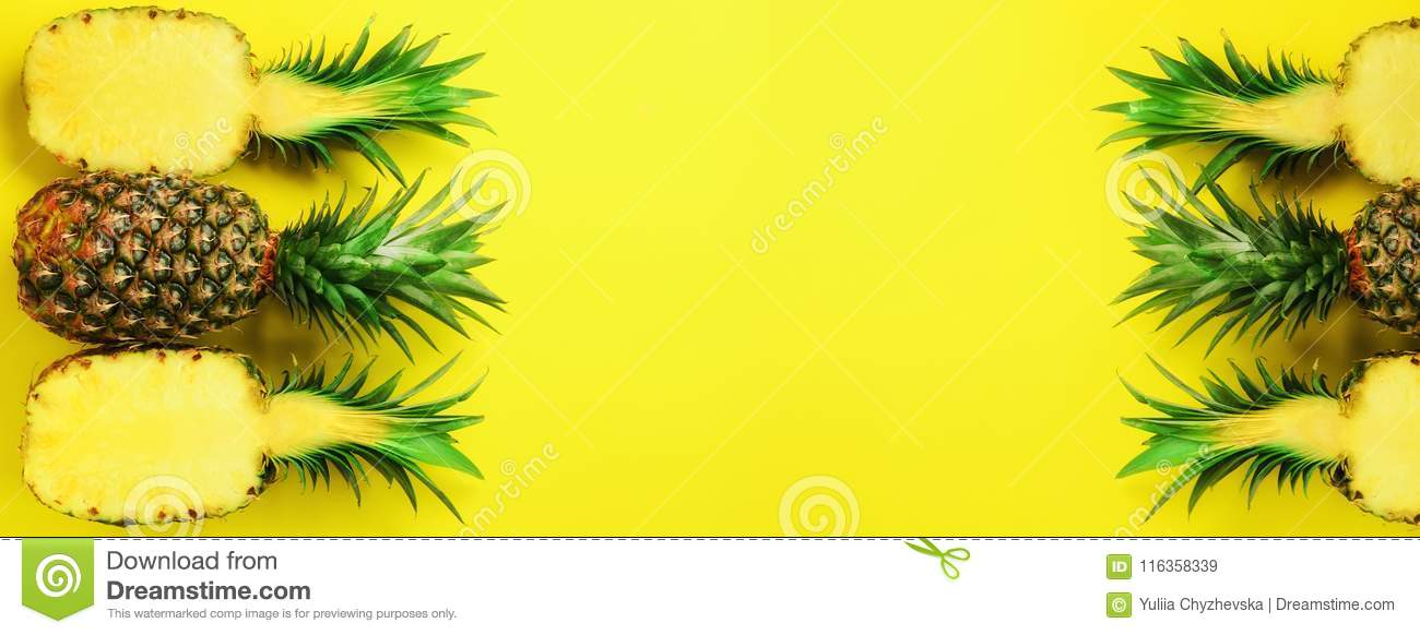 Pattern with bright pineapples on blue background. Top View. Copy Space. Minimal style. Pop art design, creative summer