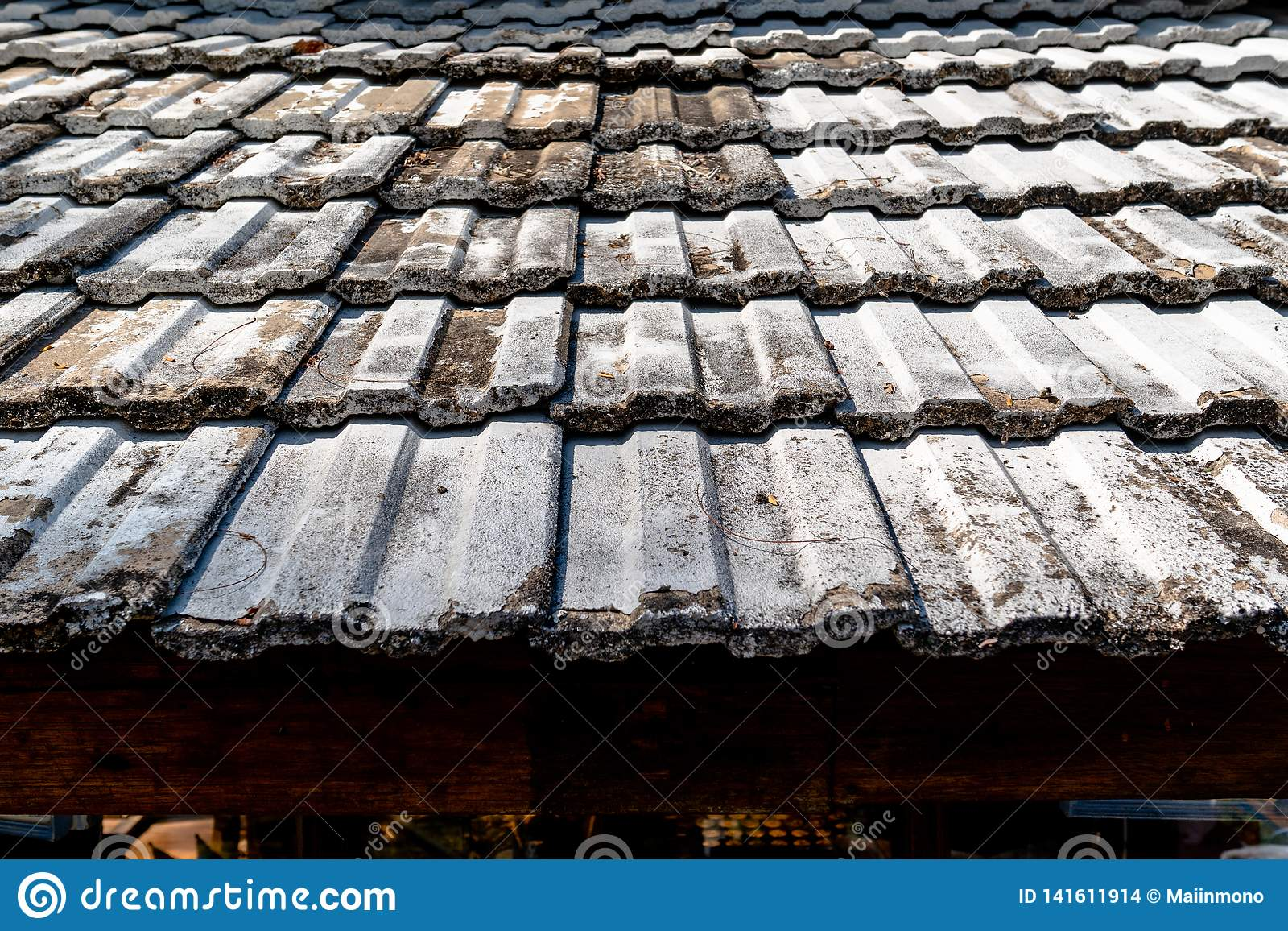 Pattern of old clay tile roof of a house with old-fashioned design.