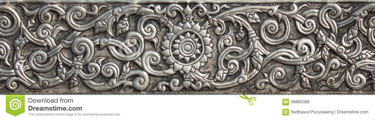 Pattern of silver metal plate with flower carved background