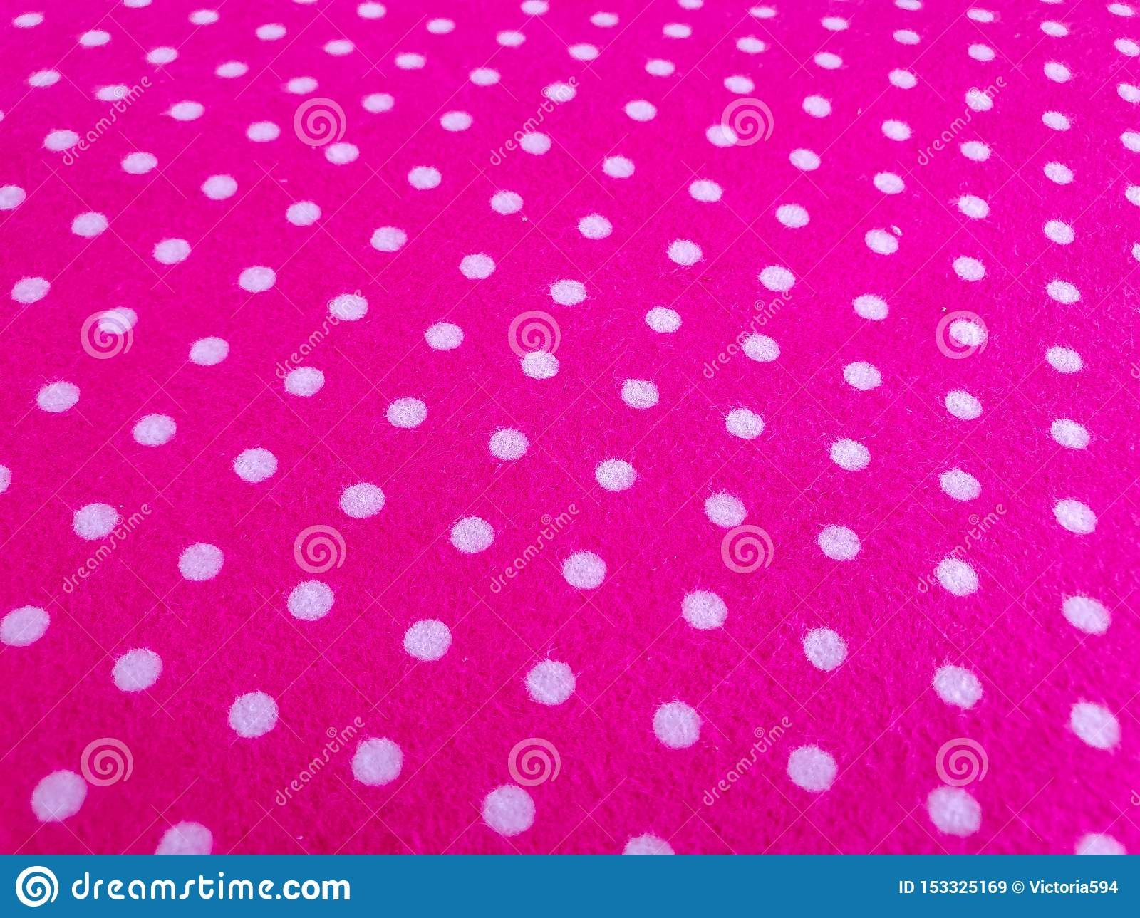 Pattern, texture, background, wallpaper. Soft bright pink cotton sample with white dots, with geometrical ornament. Close up view