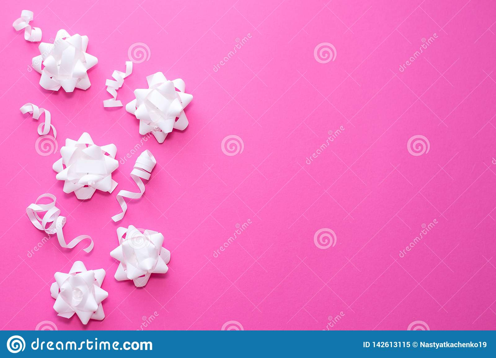 Pattern white flowers on pastel pink background. Flat lay, top view. Celebration concept