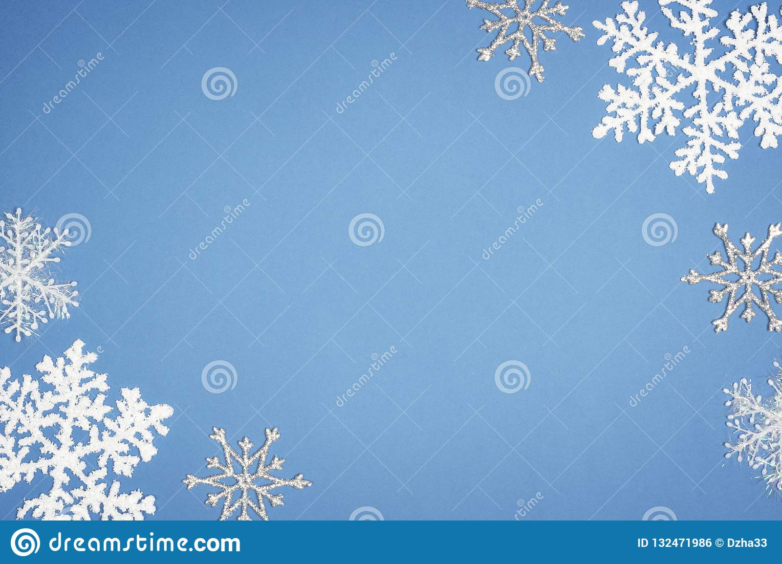 Pattern white snowflake on blue background. Christmas decor with Copy space