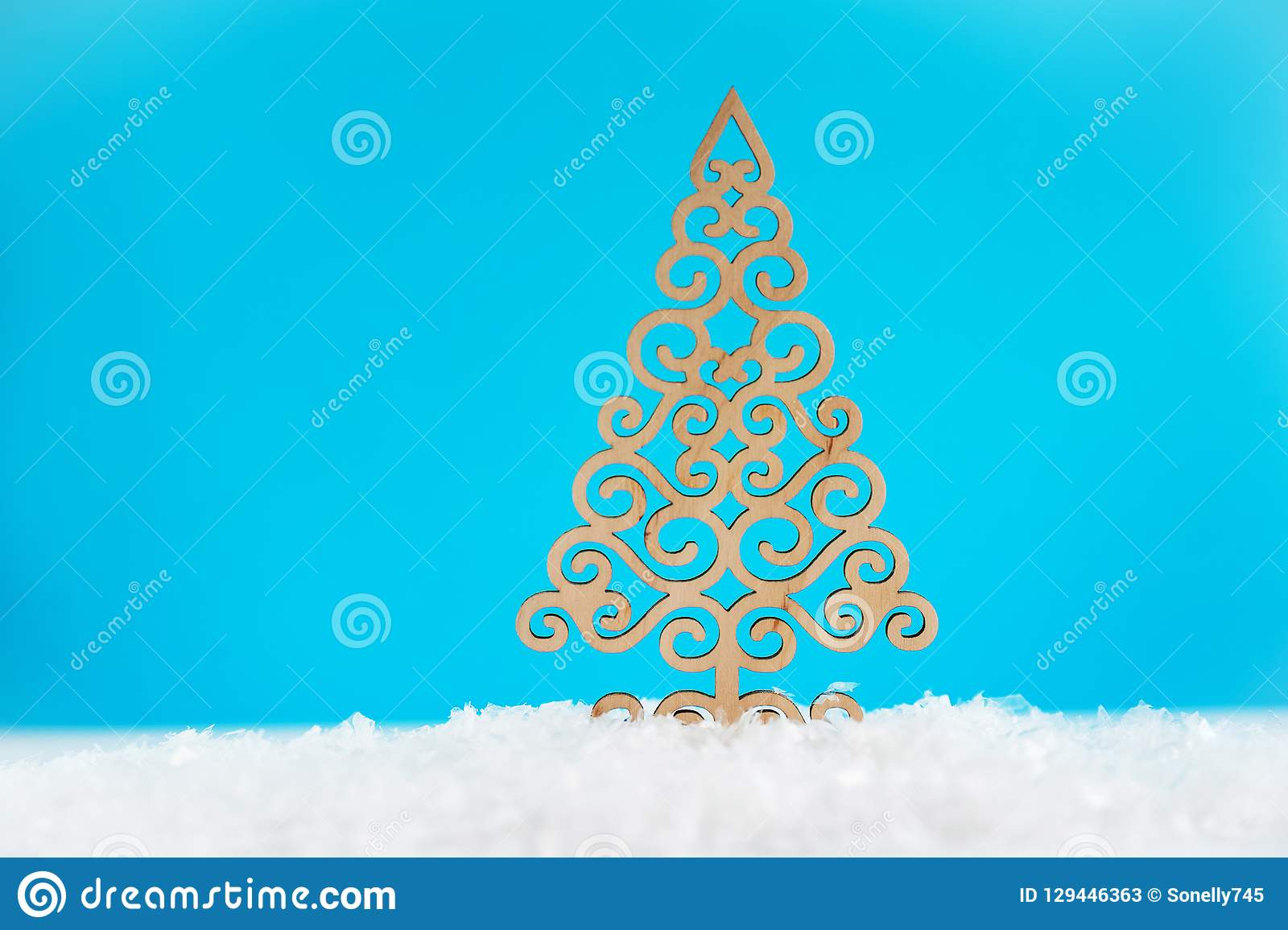 pattern of a wooden christmas tree on a blue background christmas or new year concept
