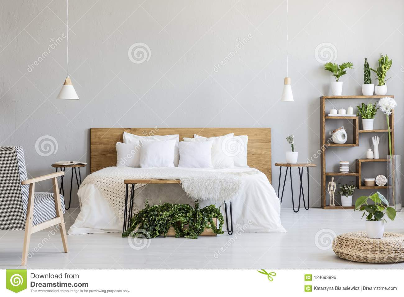 Patterned Armchair Near White Wooden Bed In Grey Bedroom ...