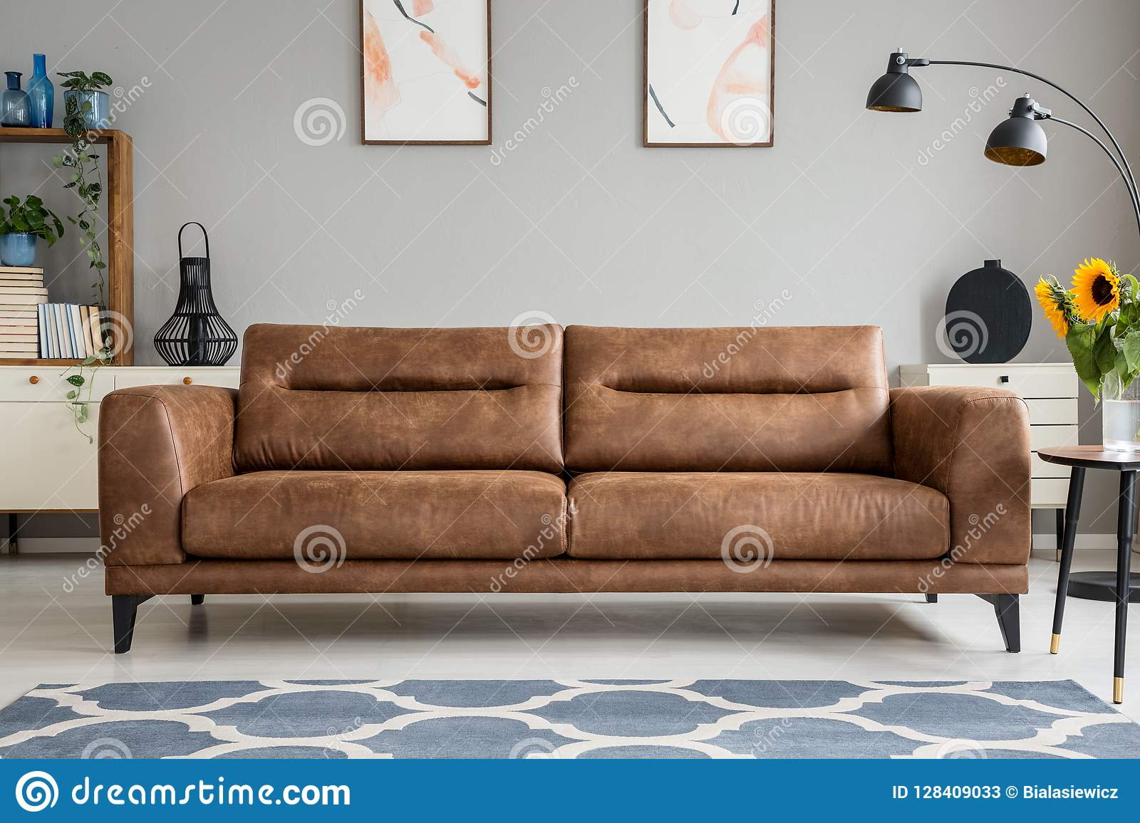 Cool Blue Carpet In Front Of Brown Leather Sofa In Grey Living Ncnpc Chair Design For Home Ncnpcorg