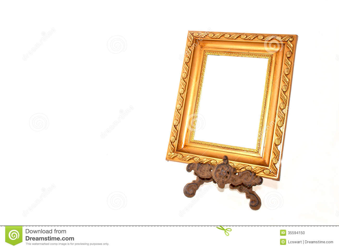 Patterned Gold Frame On Vintage Metal Stand Stock Photo