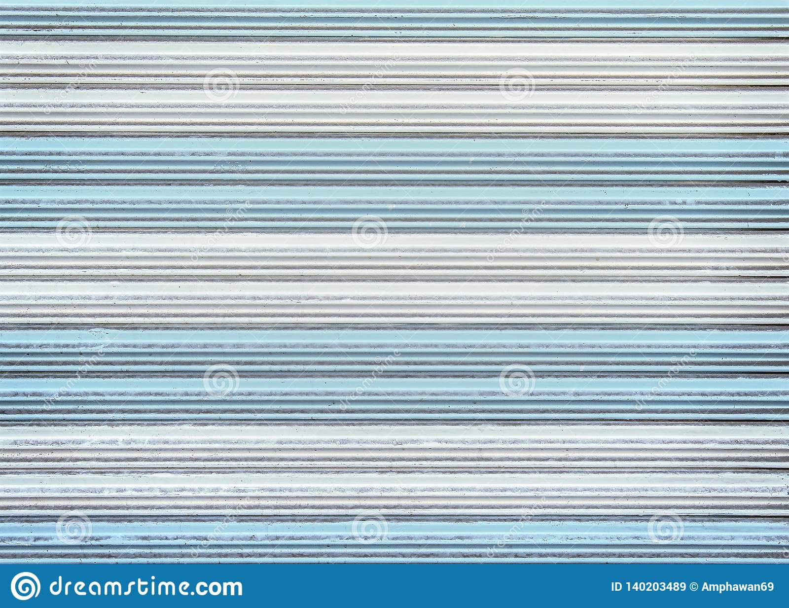 Patterns of colorful old white and blue rolling steel door texture or roller shutter door for background