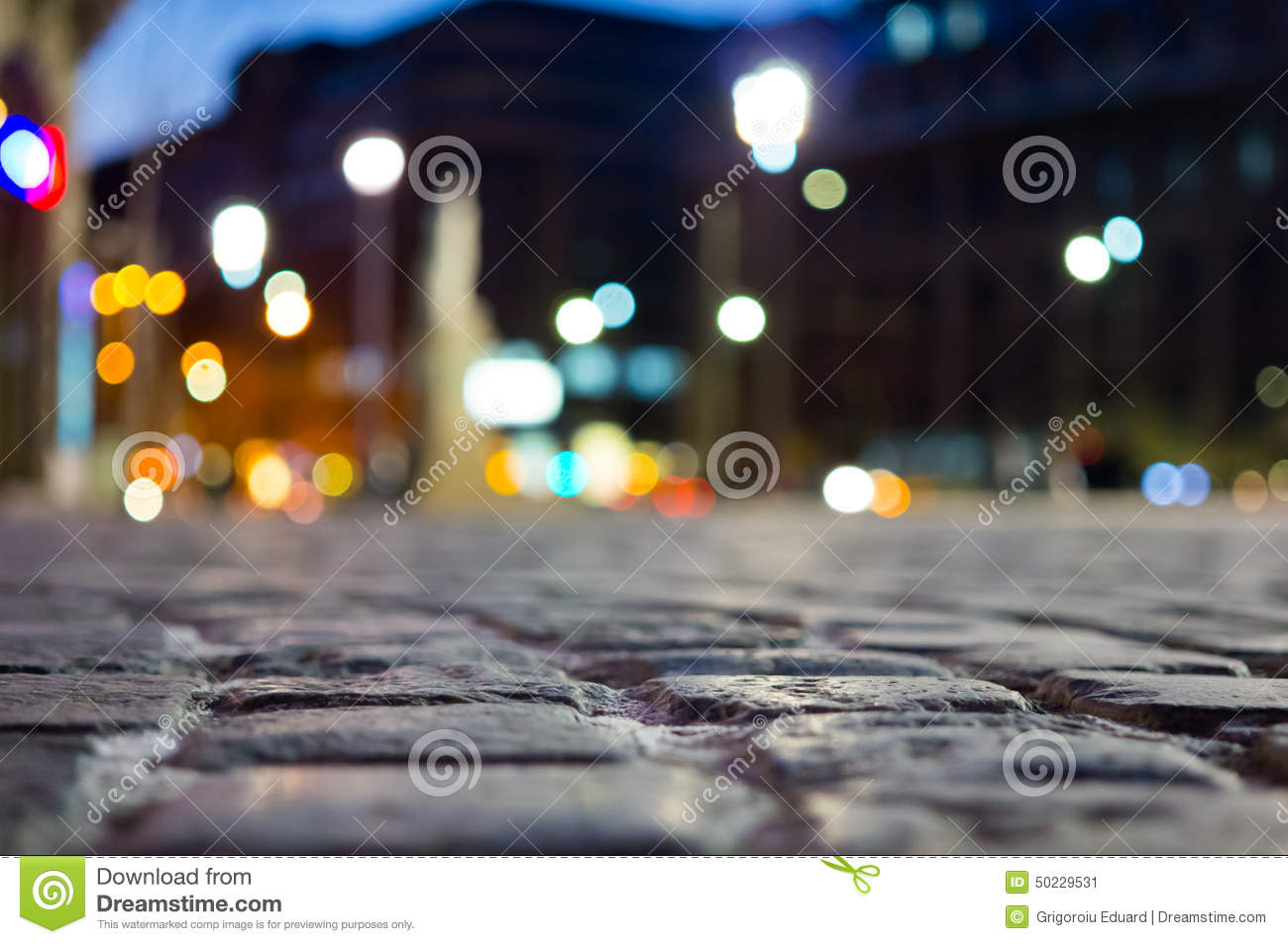 Pavement and blurred city light during night time