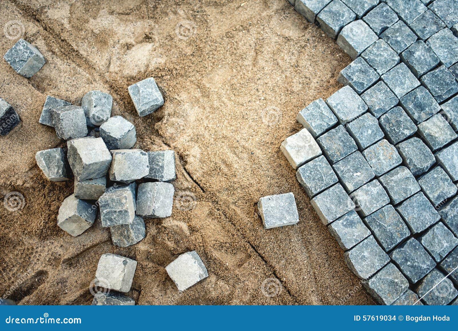 Road construction with cobblestone stock image - Piedras para construccion ...