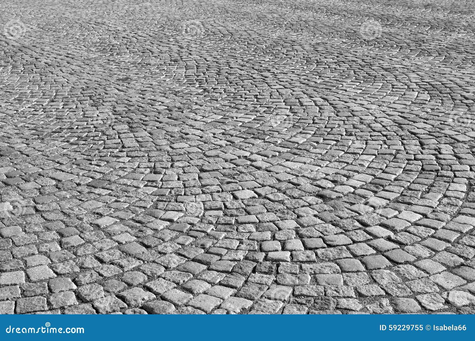 Pavimentadoras del granito de una plaza de la ciudad