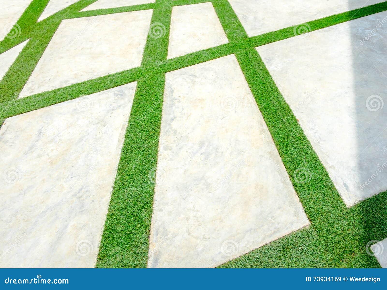 Pavimento hecho con la hierba y el bloque de cemento - Pavimento de cemento ...