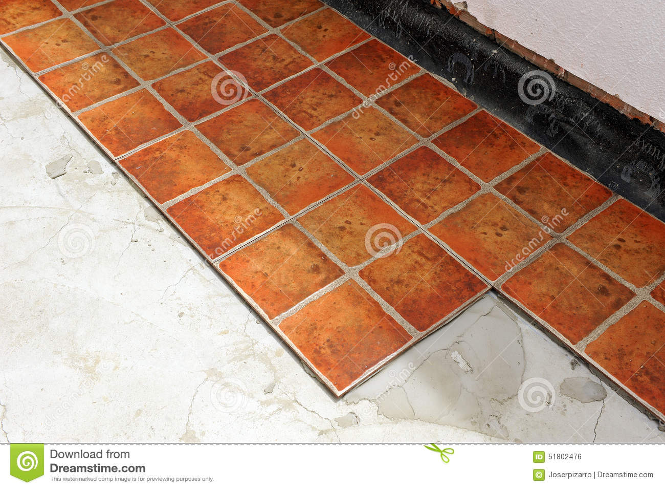Paving the floor of the courtyard of a house with ceramic tile stock paving the floor of the courtyard of a house with ceramic tile installation hitting dailygadgetfo Images
