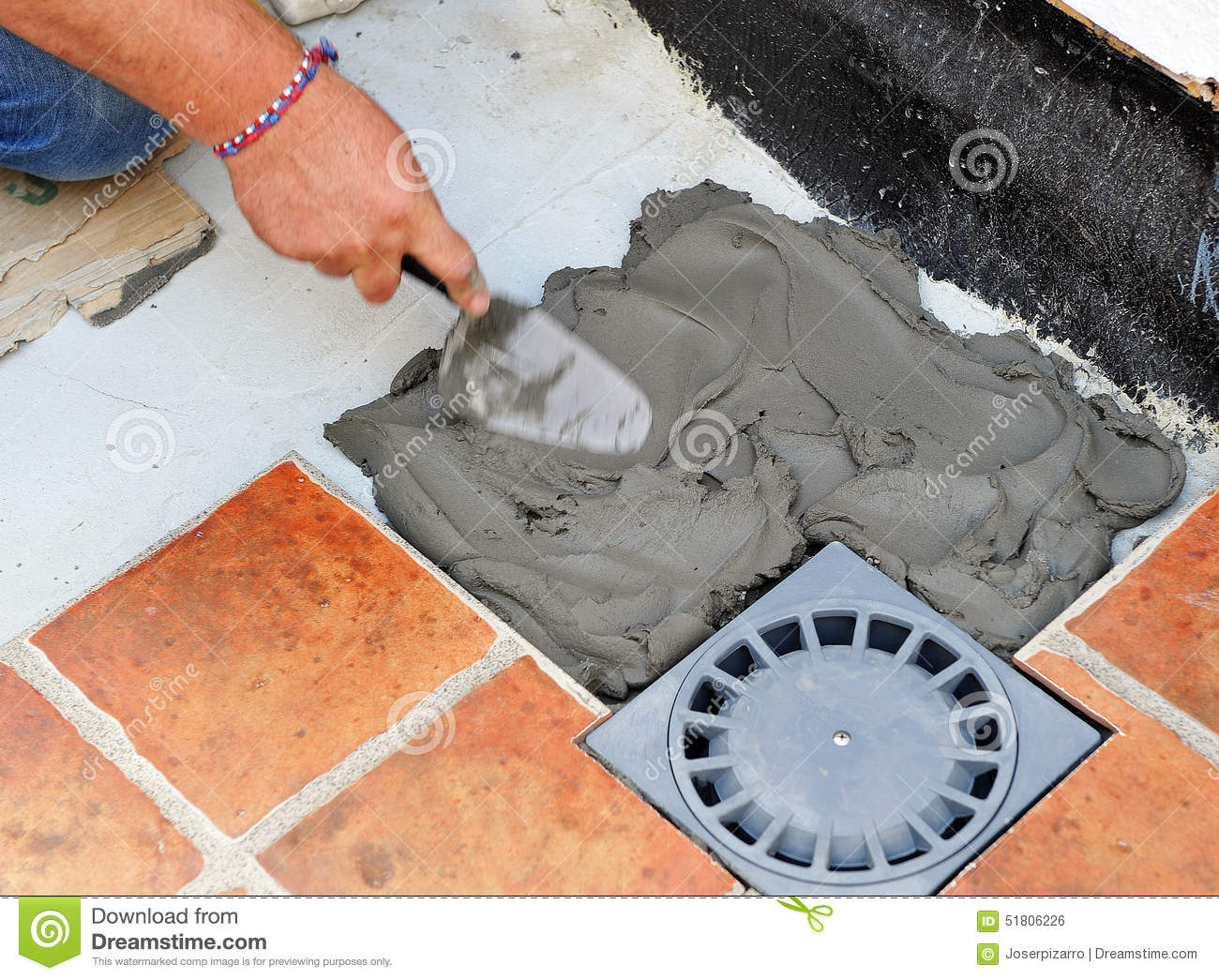 Paving the floor of the courtyard of a house with ceramic tile stock royalty free stock photo dailygadgetfo Images