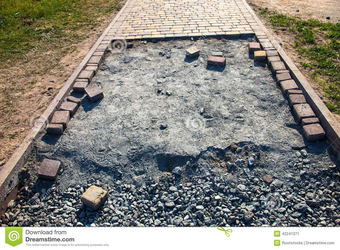 Paving the footpath with the tiled cubes stock photo for Paving planner