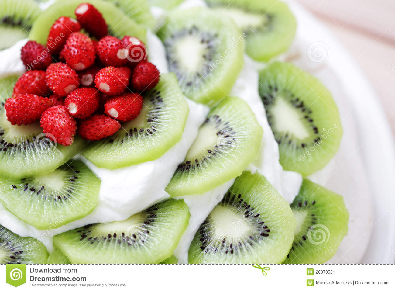Delicious Pavlova with kiwi and wild strawberry - sweet food.