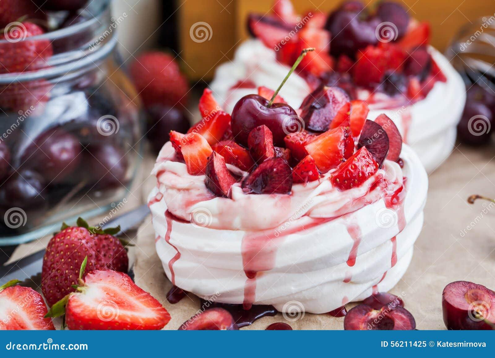 Pavlova Meringue Cake With Fresh Strawberry And Cherry Stock Image