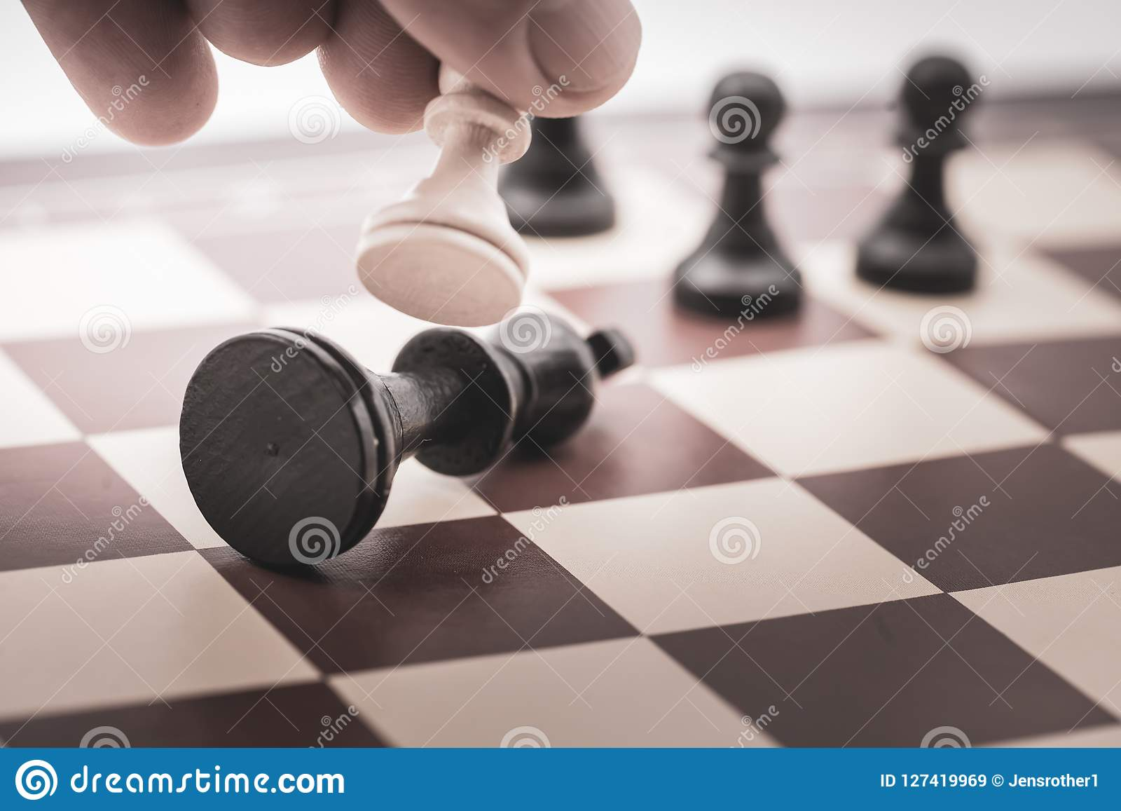 Pawn beats the king on a chess board