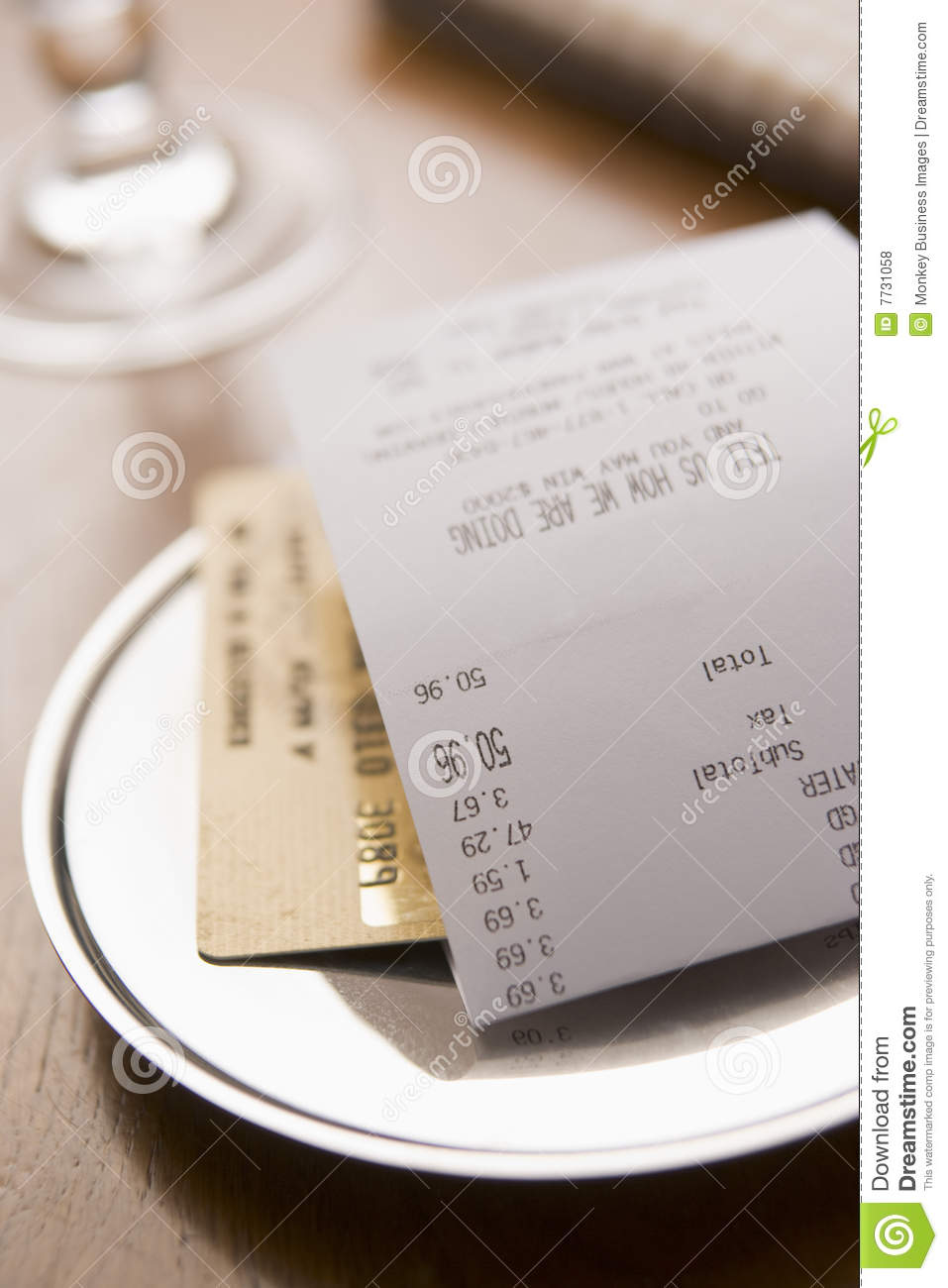 paying restaurant bill with a credit card royalty free