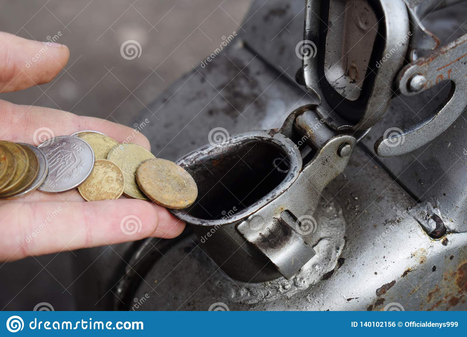 Payment for the gas, fuel, gasoline, diesel concept. Hand dropping money, coin in the can of fuel