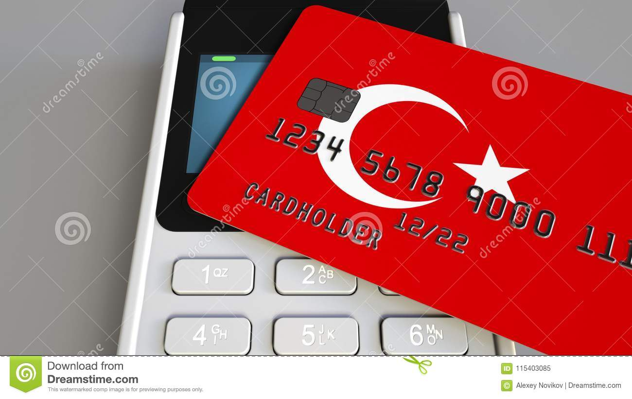 Payment or POS terminal with credit card featuring flag of Turkey. Turkish retail commerce or banking system conceptual