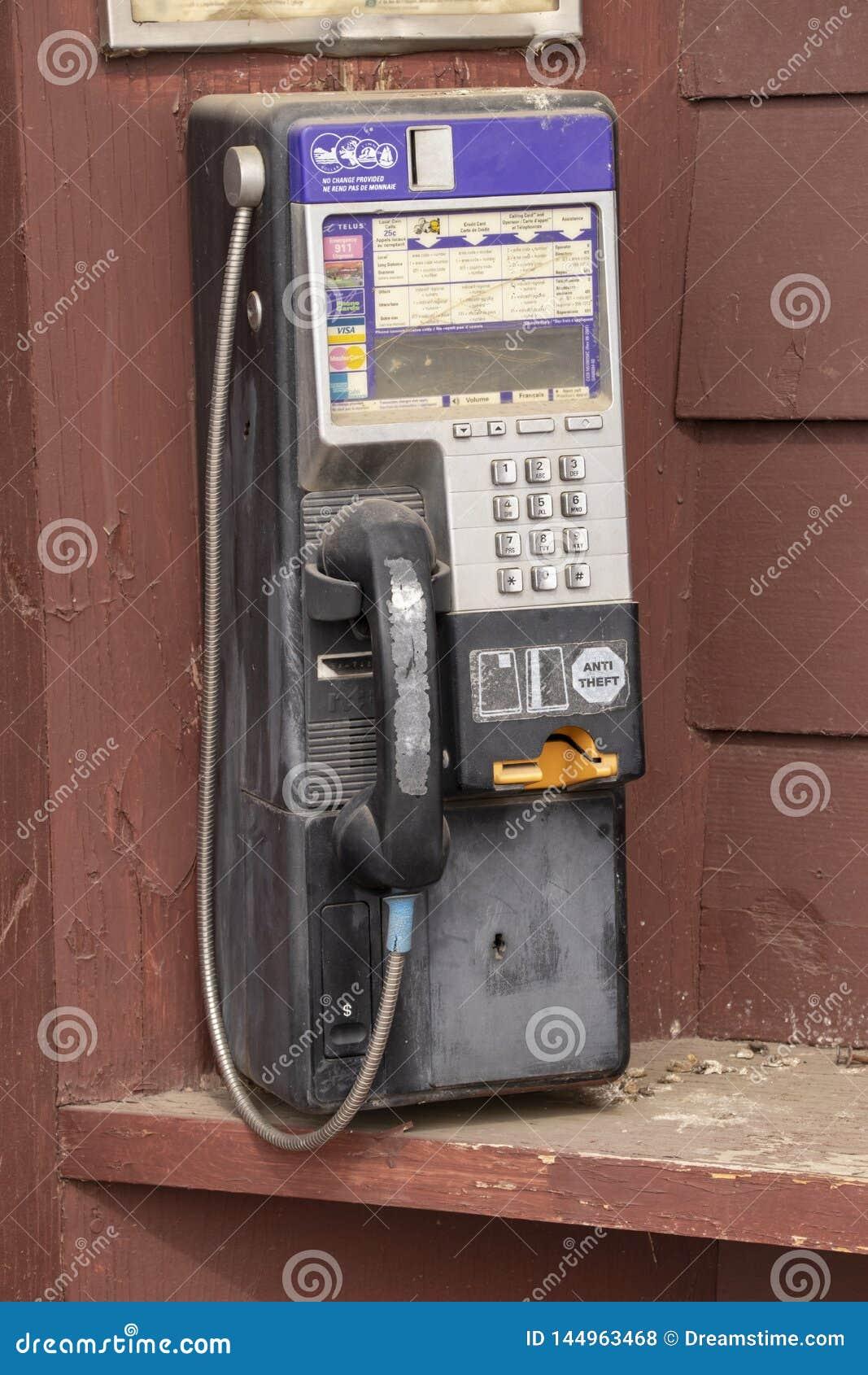 Payphone op een houten achtergrond