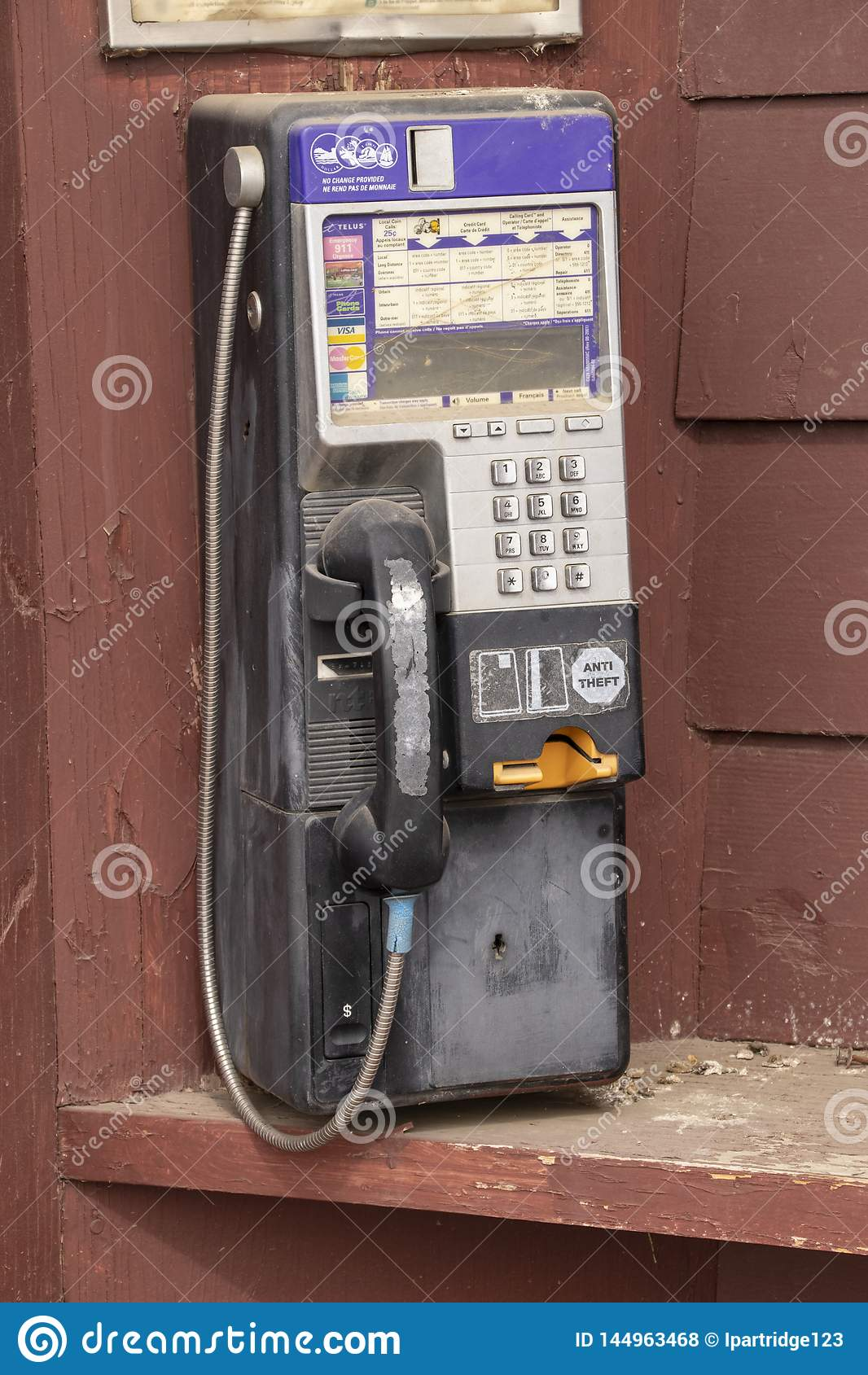 A payphone on a wood background