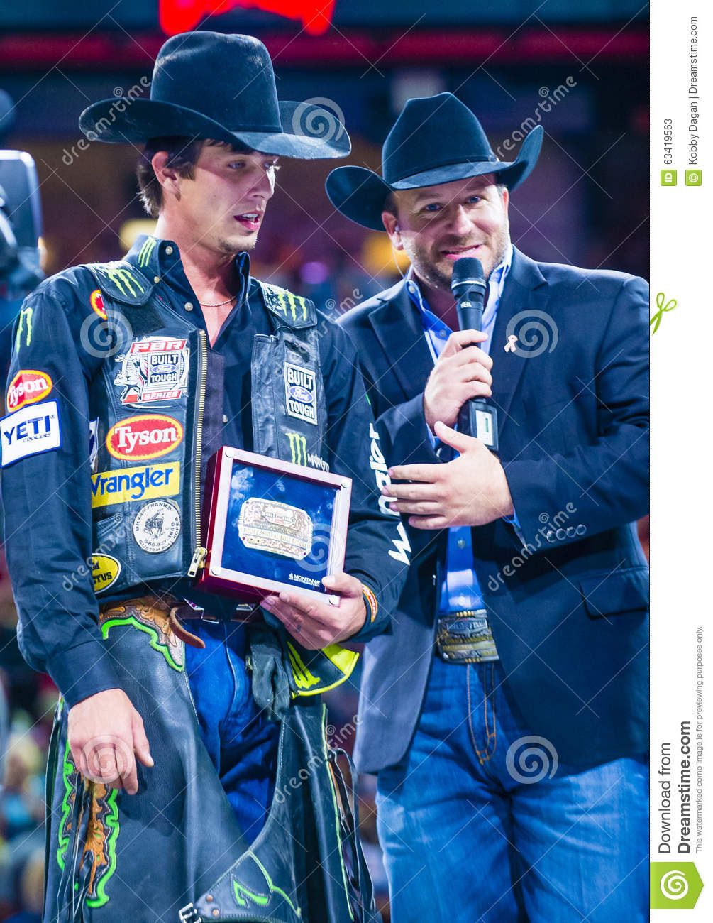 1e2601fb35632 LAS VEGAS - OCT 24   J.B. Mauney (L) Being interviewed on stage after  winning the PBR bull riding world finals. The bull riding world championship  held in ...