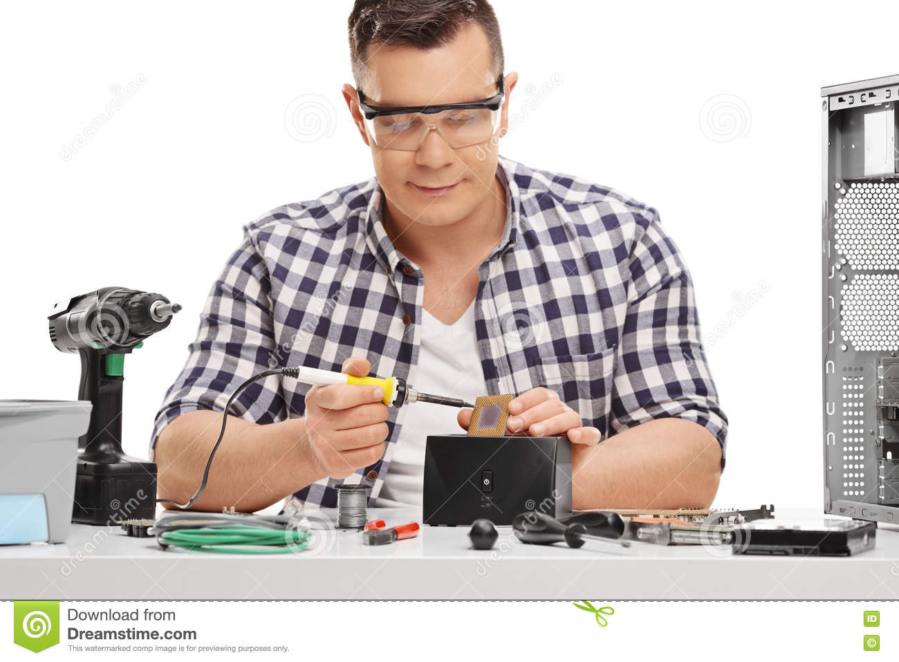 pc technician working with soldering iron stock photo image 70489946. Black Bedroom Furniture Sets. Home Design Ideas