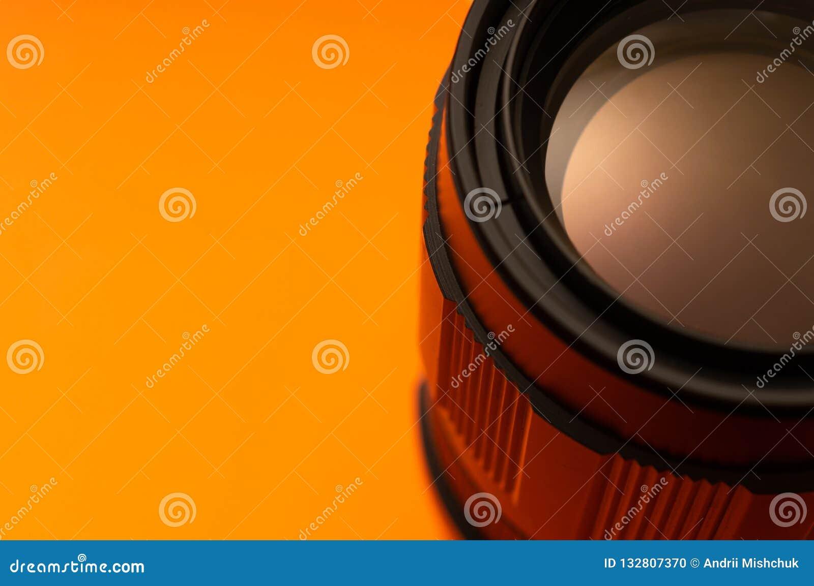 Peça da lente da foto no fundo alaranjado