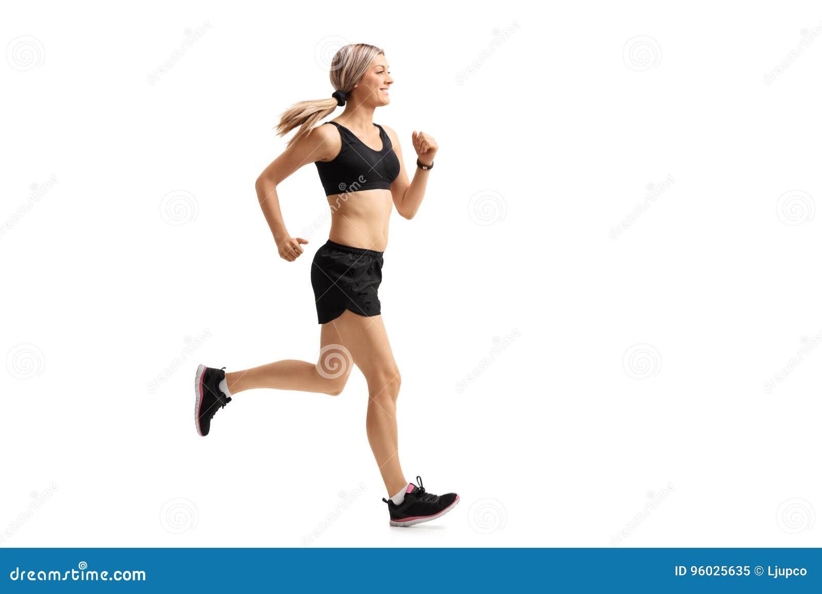 Pełny długość profil strzelał kobieta bieg