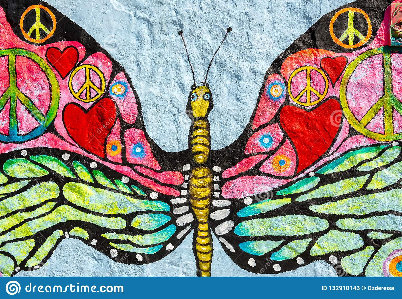 peace concepts painted over butterfly painting on grunge wall