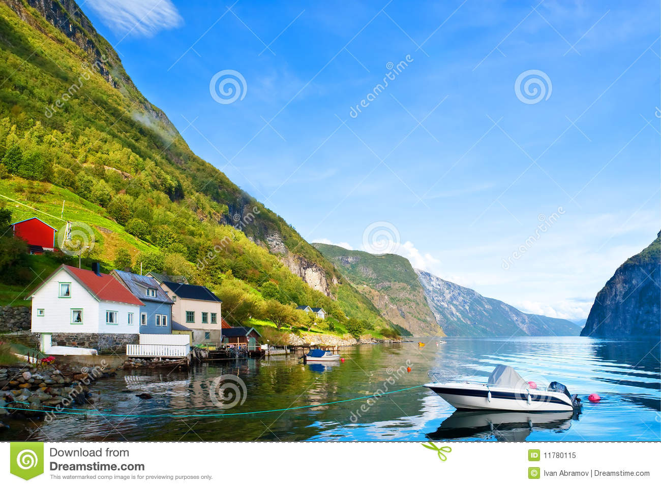 Peaceful boat on fjord in sunny day
