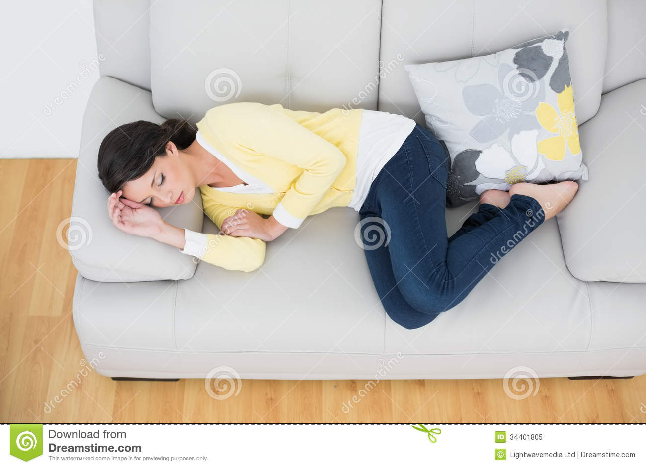 Peaceful Casual Brunette In Yellow Cardigan Sleeping On The Couch – Sleeping in the Living Room