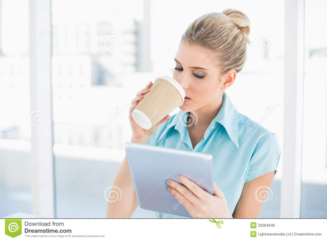 Peaceful Classy Woman Using Tablet While Drinking Coffee ...