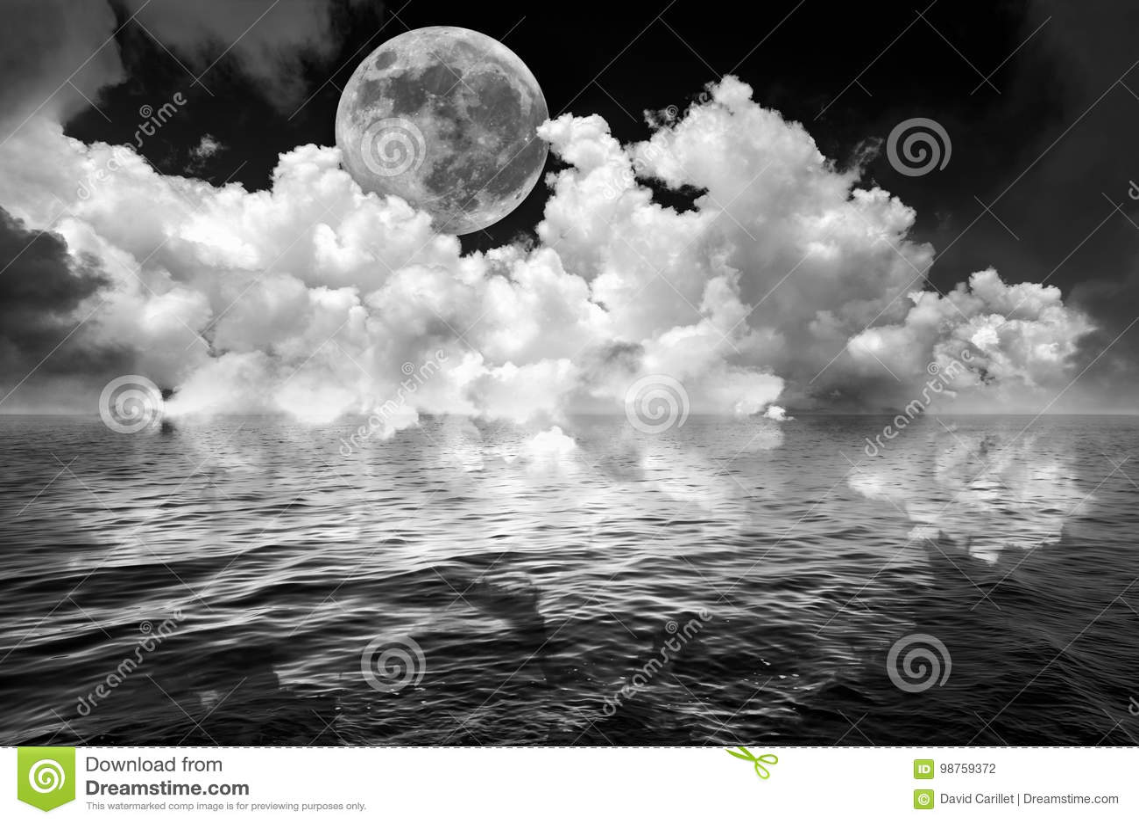 Full moon and clouds in dark fantasy night sky reflected in wavy ocean water