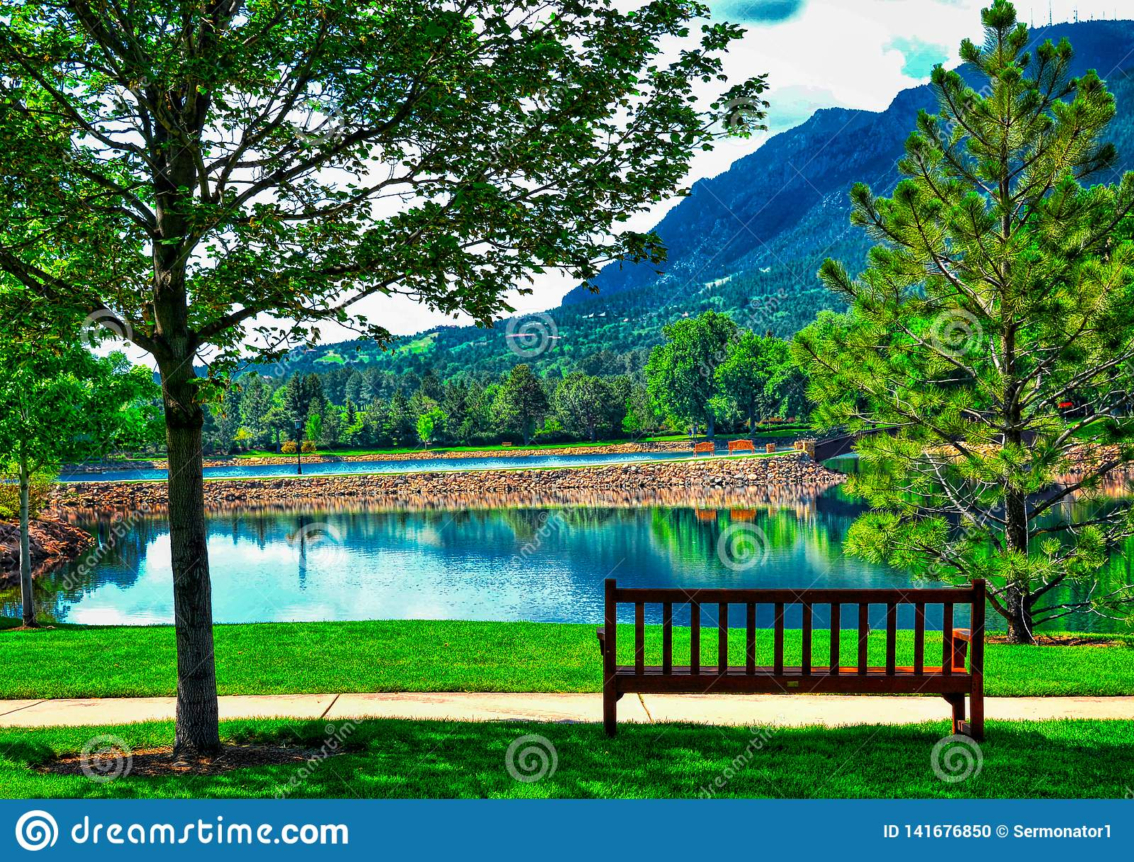 A Peaceful and Idyllic Image at the Broadmoor Hotel at Cheyene Mountain Lake and bench