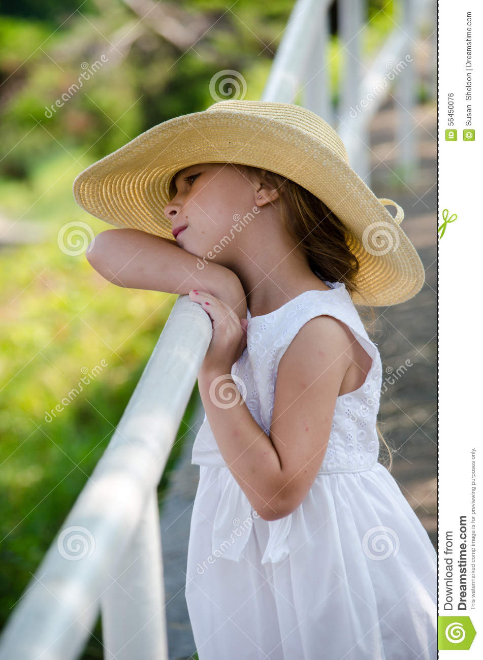 Peaceful Little Girl In A Straw Hat Stock Photo - Image of dreaming ... 73746bb7bf0